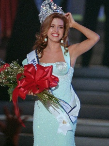 Newly crowned Miss Universe, Alicia Machado, from Maracay, Venezuela poses after receiving her crown during the Miss Universe Pageant in Las Vegas, Friday, May 17, 1996. Miss Universe is hitting the gym, trying to reduce her weight in light of  recent criticism. (AP Photo/Lennox McLendon)